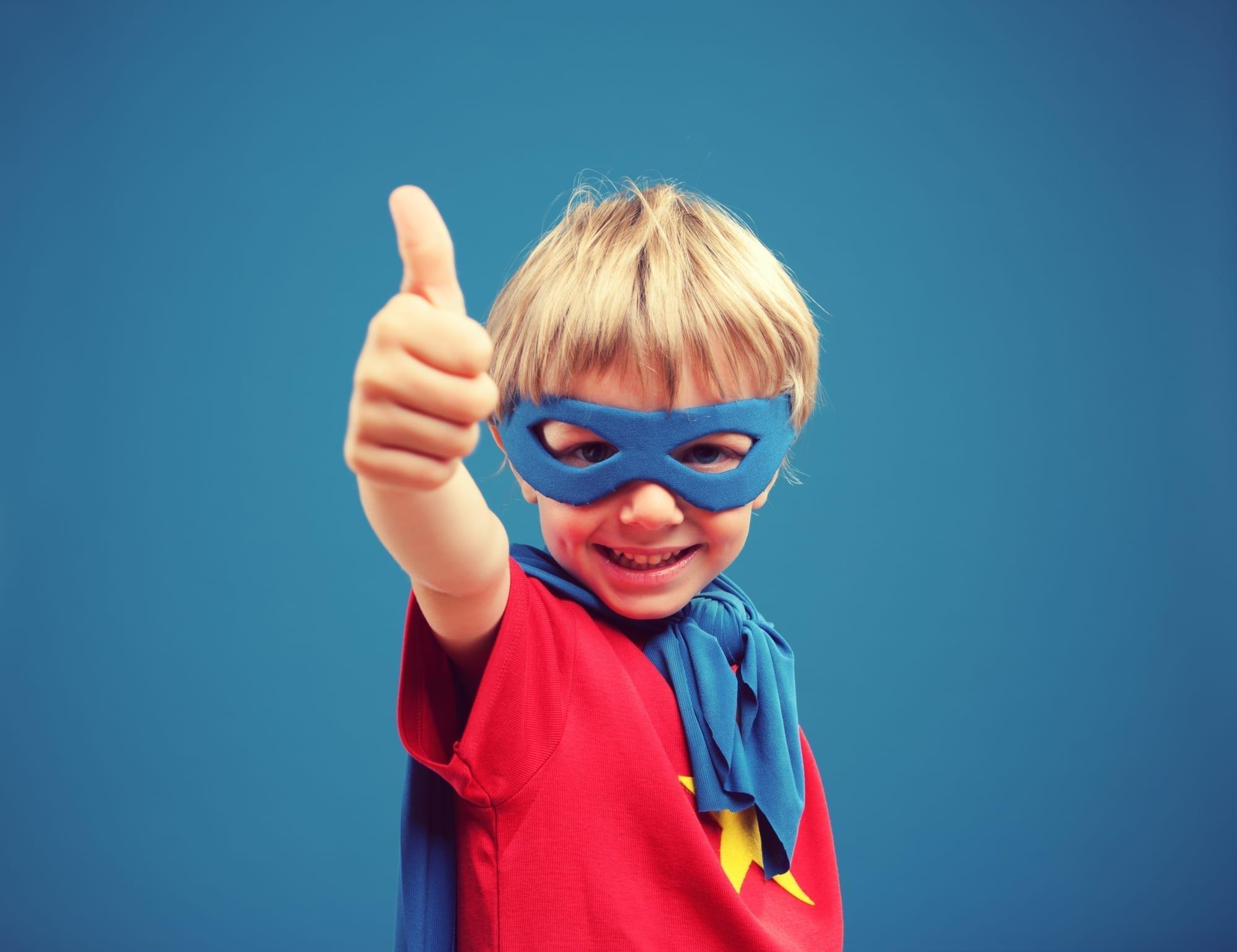 kid dressed as superhero