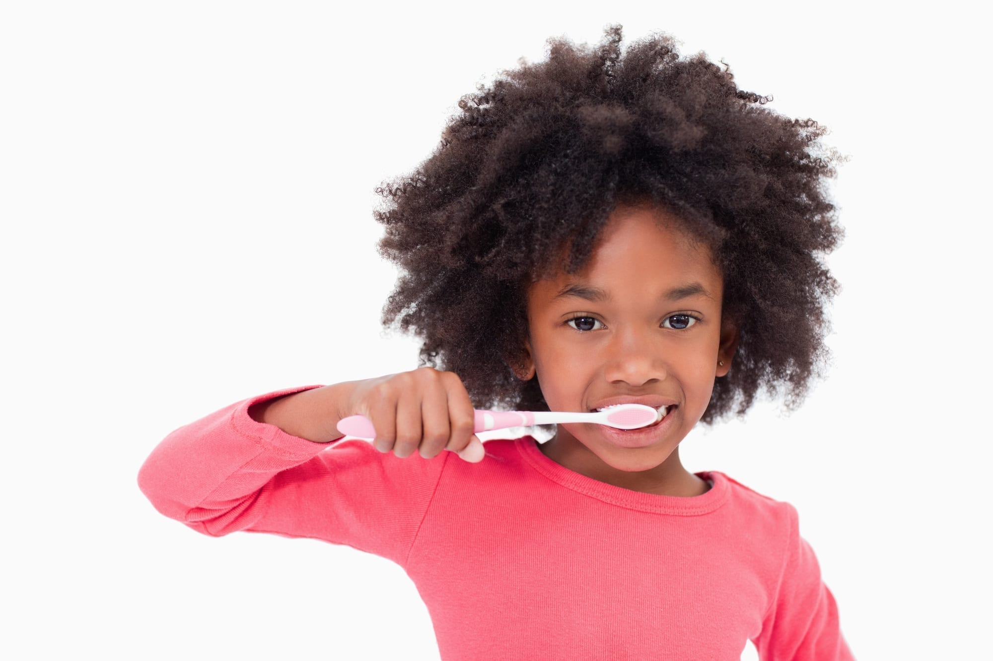 little girl brushing teeth on white background