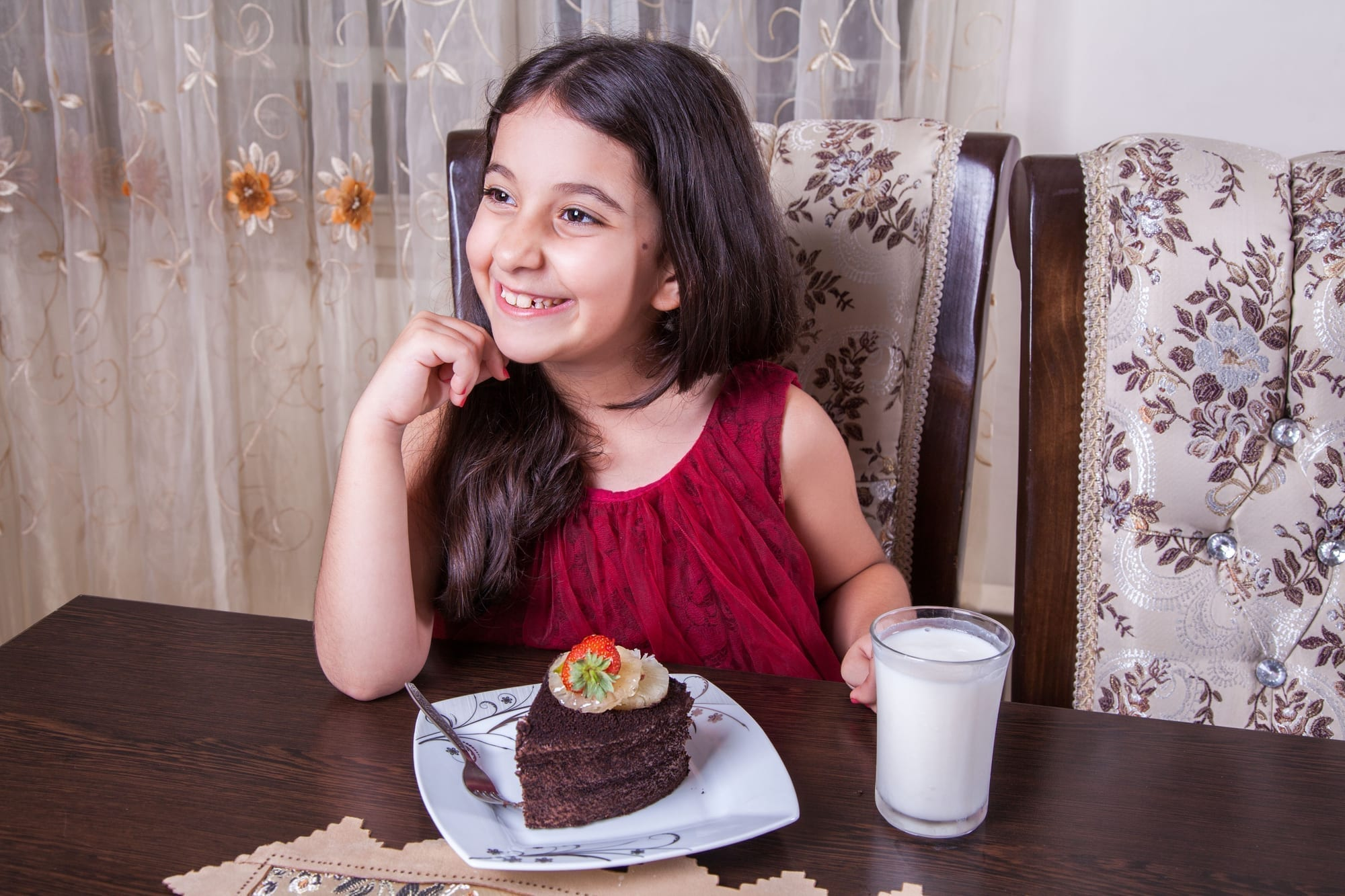little girl with chocolate cake
