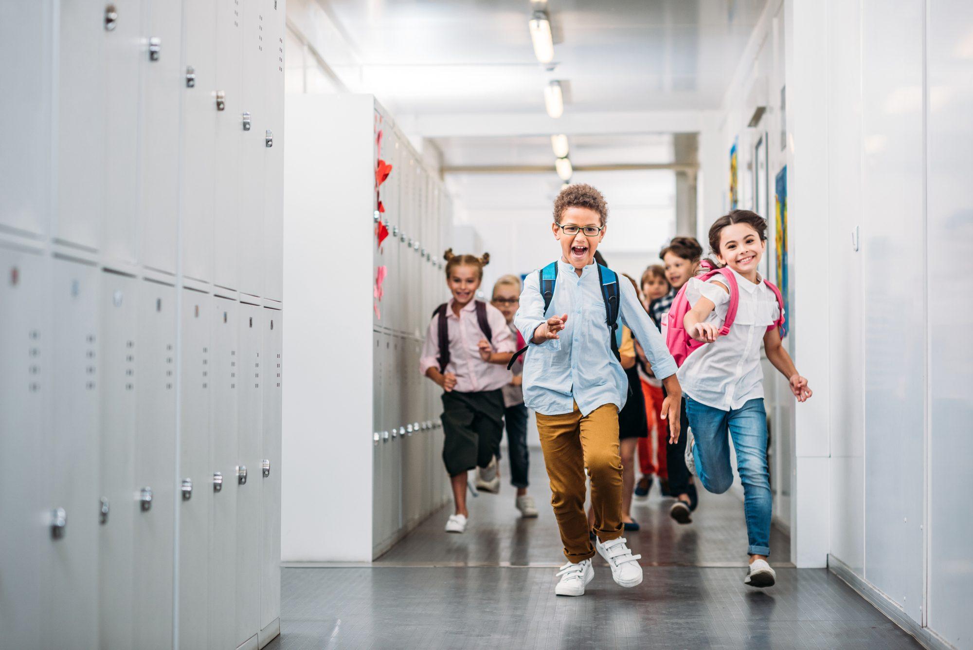 children running in the hallway in school